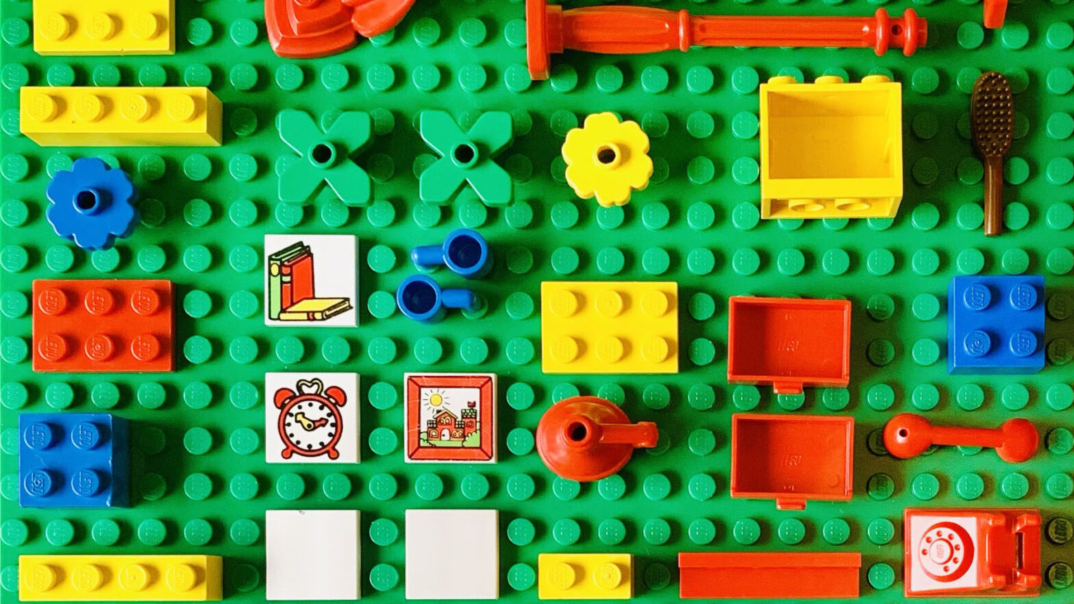 Colourful LEGO elements laid out neatly.
