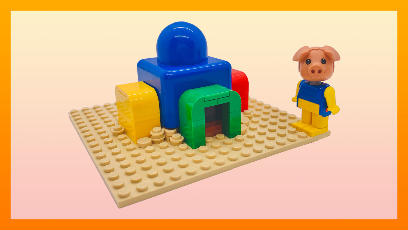 Pig minifigure standing next to a large blue Primo brick surrounded by yellow, red and green System extensions.